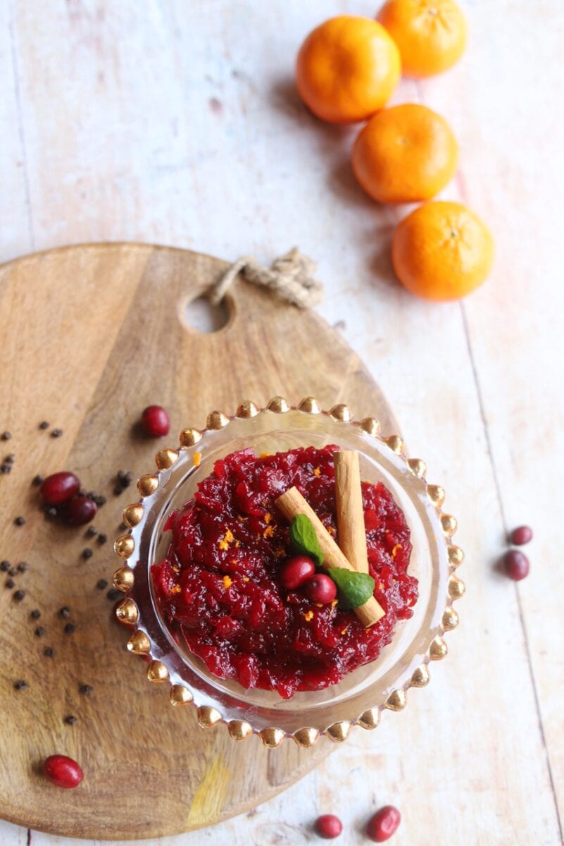 Pin image of cranberry sauce alongside oranges and spices