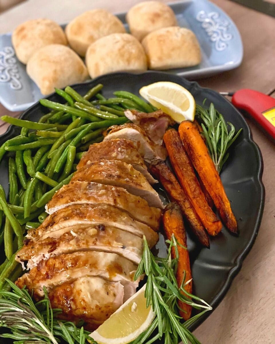 Rosated turkey on platter with vegetables