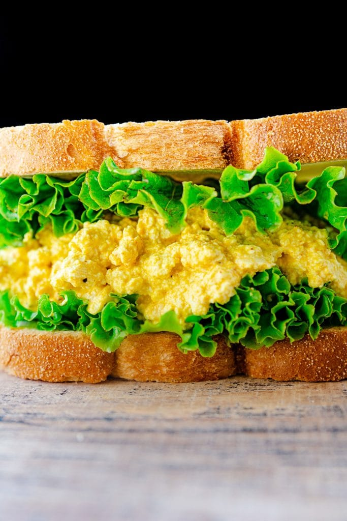 Image of closeup of vegan egg sandwich with lettuce.
