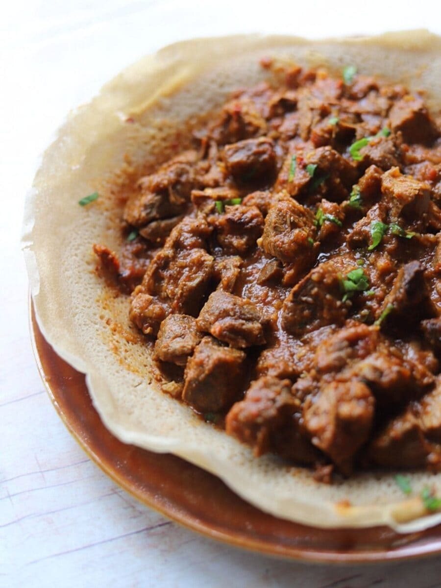 side view of zigni on injera