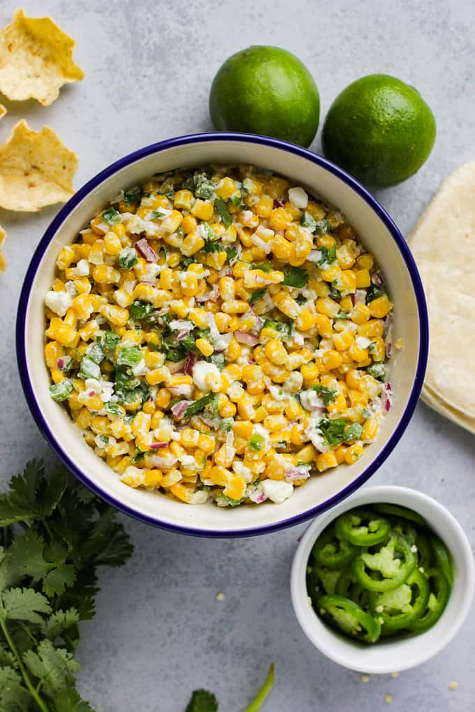 Mexican corn salad in large white bowl