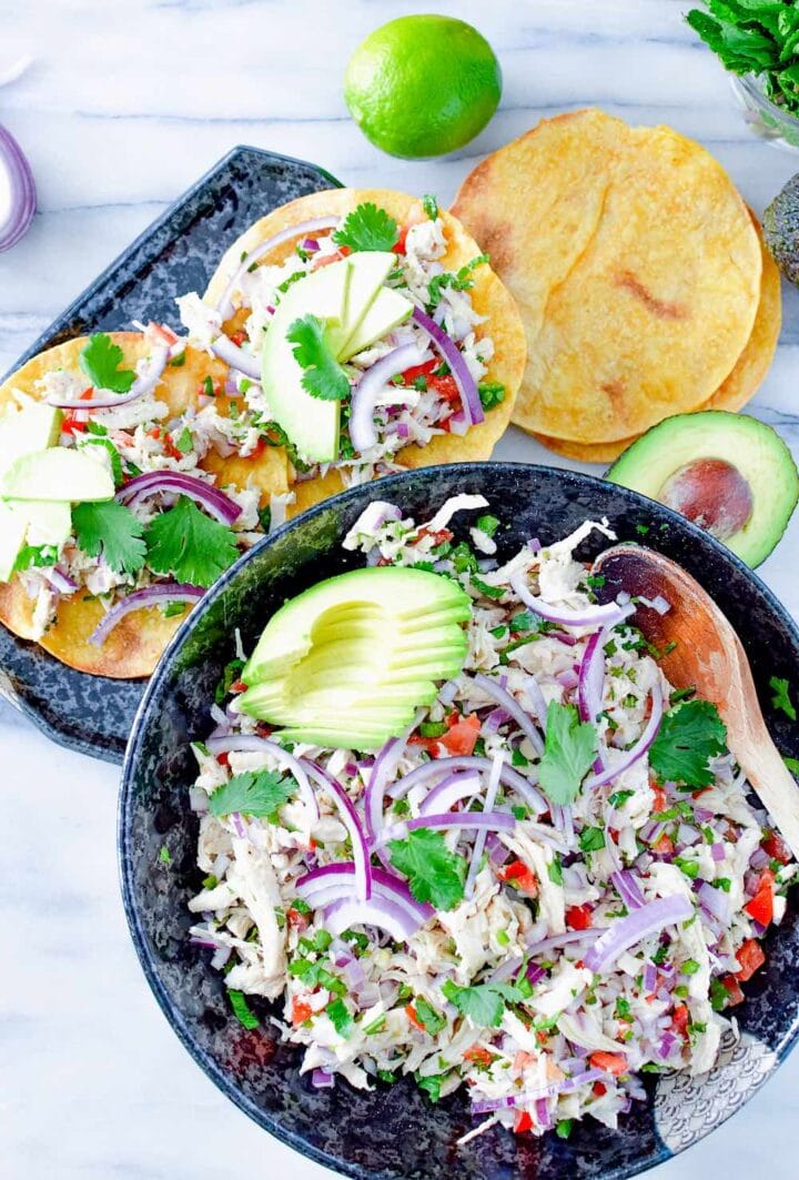 Image of chicken salad in large bowl and served on two tortillas.