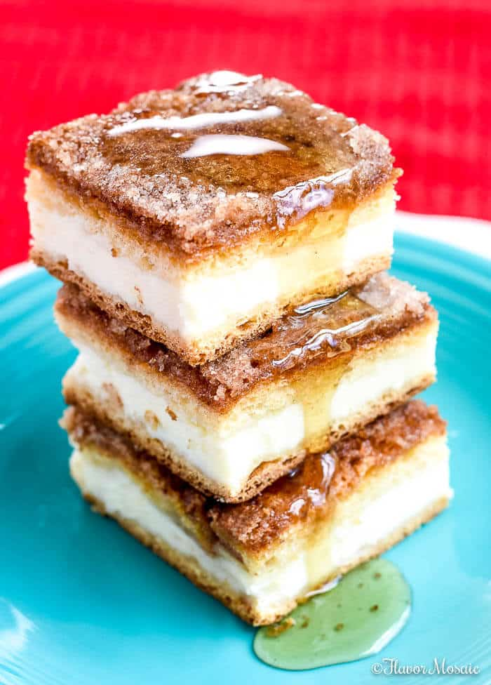 stack of three sopapilla cheesecake bars on a blue plate