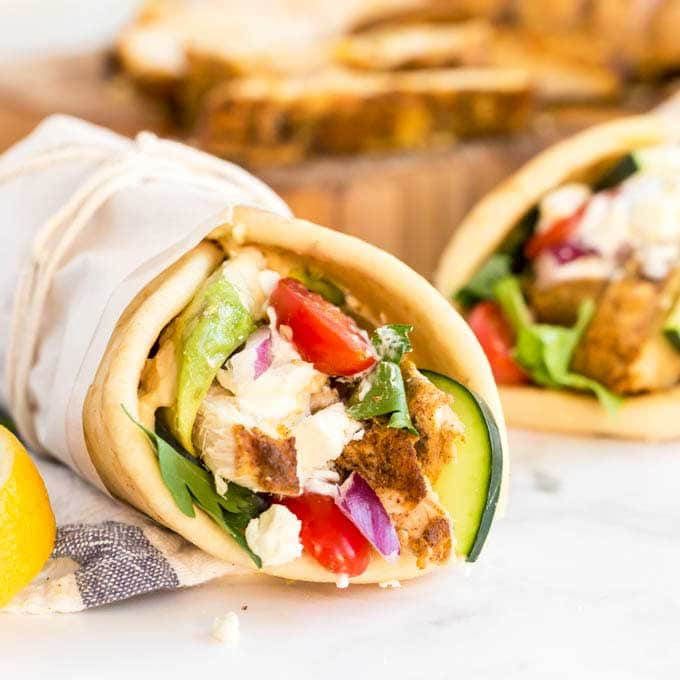 Image of two chicken and salad filled shawarma wraps.