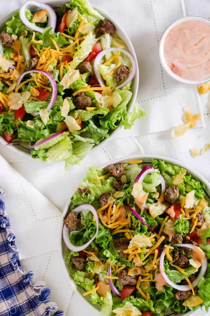 Image of two bowls of salad with broken up beef patty.