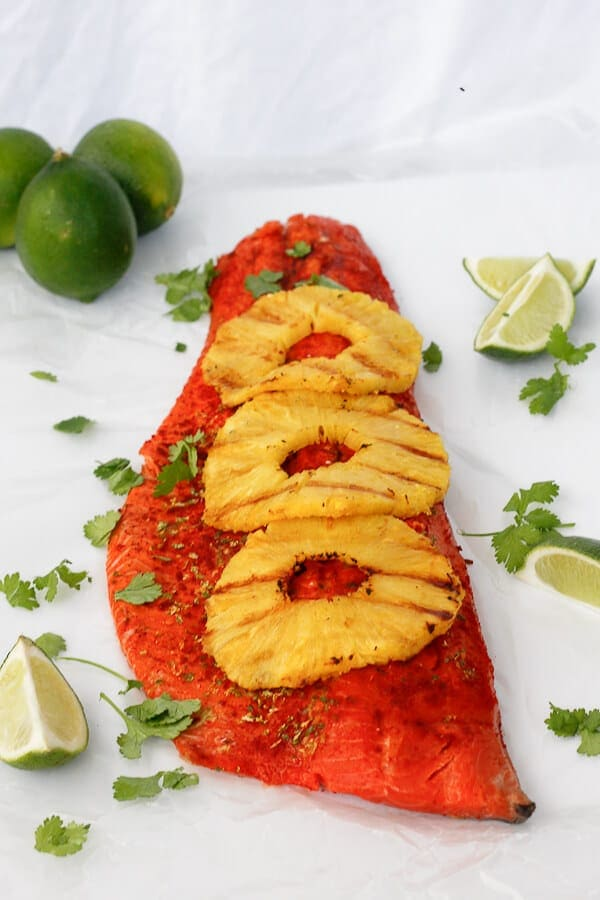 Image of grilled side of salmon with three rings of pineapple.