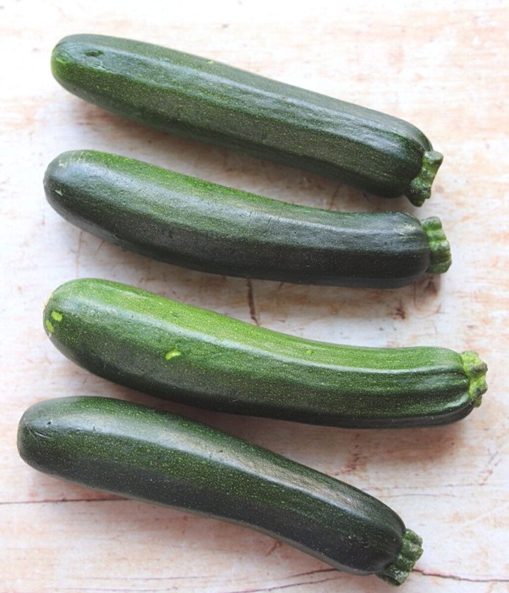 Image of four green zucchini.