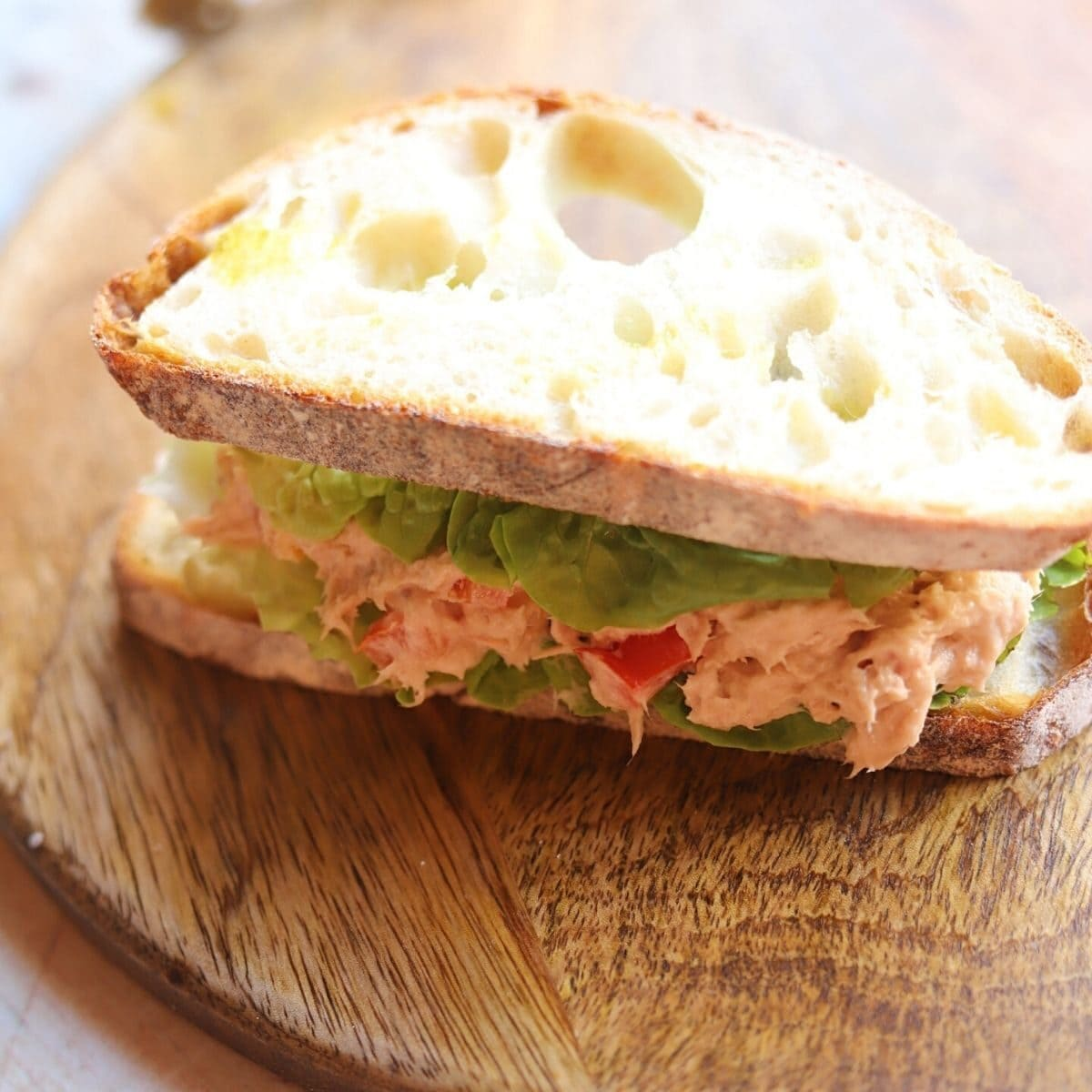 Full sandwich with tuna mix and lettuce.