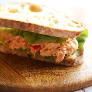 Close up of sandwich with tuna mix and lettuce.