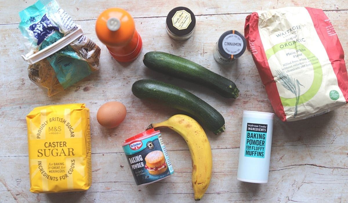 Ingredients laid out on table for zucchini banana bread.